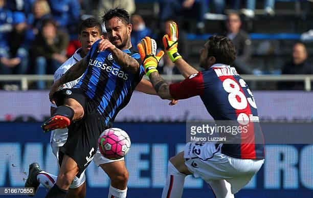 Mauricio Pinilla of Atalanta BC is challenged by Antonio Mirante of Bologna FC during the Serie A match between Atalanta BC and Bologna FC at Stadio...