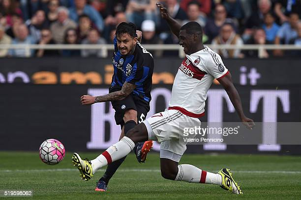 Mauricio Pinilla of Atalanta BC is challenged by Cristian Zapata of AC Milan during the Serie A match between Atalanta BC and AC Milan at Stadio...