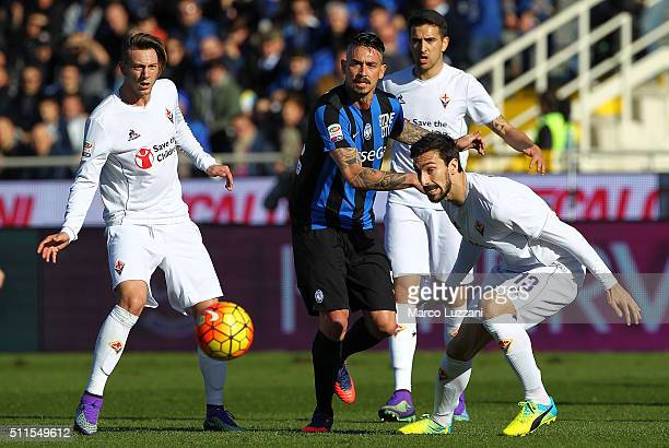 Mauricio Pinilla of Atalanta BC is challenged by Federico Bernardeschi and Davide Astori of ACF Fiorentina during the Serie A match between Atalanta...
