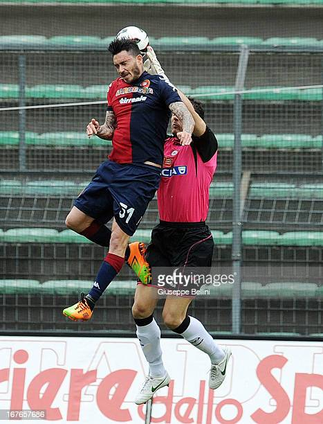 Mauricio Pinilla of Cagliari and Zeljko Brkic of Udinese in action during the Serie A match between Cagliari Calcio and Udinese Calcio at Stadio...