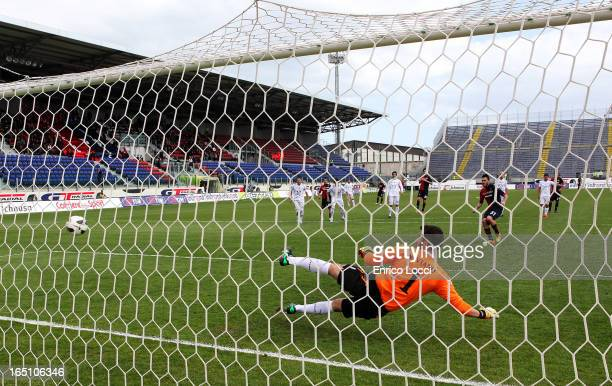 Mauricio Pinilla of Cagliari Calcio scores a goal from the penalty spot during the Serie A match between Cagliari Calcio and ACF Fiorentina at Stadio...