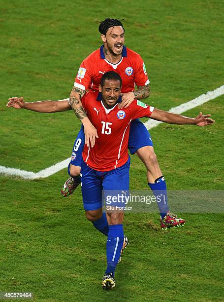Mauricio Pinilla of Chile celebrates his team's third goal scored by Jean Beausejour during the 2014 FIFA World Cup Brazil Group B match between...