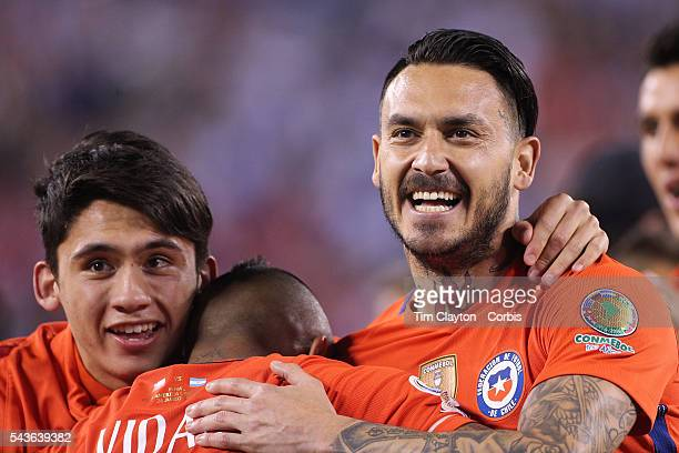 Mauricio Pinilla of Chile celebrates victory with Arturo Vidal of Chile during the Argentina Vs Chile Final match of the Copa America Centenario USA...
