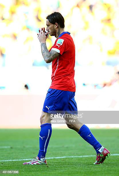 Mauricio Pinilla of Chile reacts after his penalty saved in a penalty shootout during the 2014 FIFA World Cup Brazil Round of 16 match between Brazil...