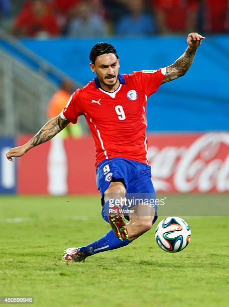 Mauricio Pinilla of Chile shoots during the 2014 FIFA World Cup Brazil Group B match between Chile and Australia at Arena Pantanal on June 13 2014 in...