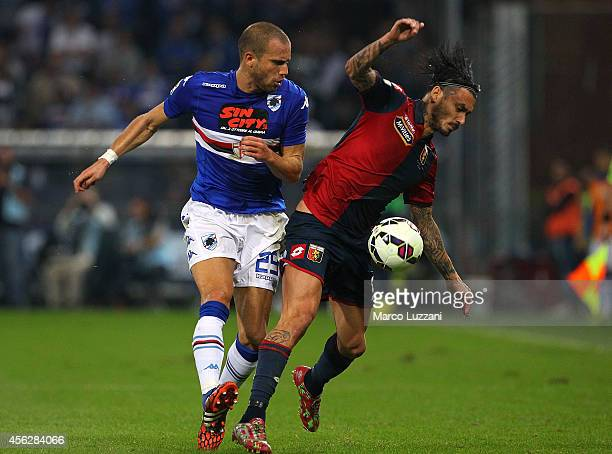 Mauricio Pinilla of Genoa CFC competes for the ball with Lorenzo De Silvestri of UC Sampdoria during the Serie A match between Genoa CFC and UC...