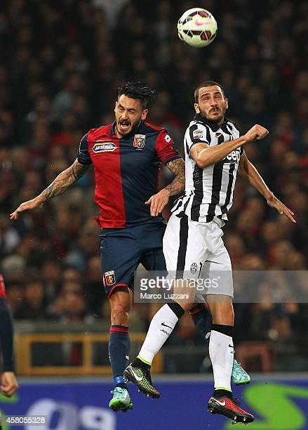 Mauricio Pinilla of Genoa CFC competes with Leonardo Bonucci of Juventus FC during the Serie A match between Genoa CFC and Juventus FC at Stadio...