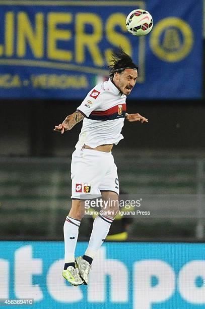 Mauricio Pinilla of Genoa CFC heads the ball during the Serie A match between Hellas Verona FC and Genoa CFC at Stadio Marc'Antonio Bentegodi on...