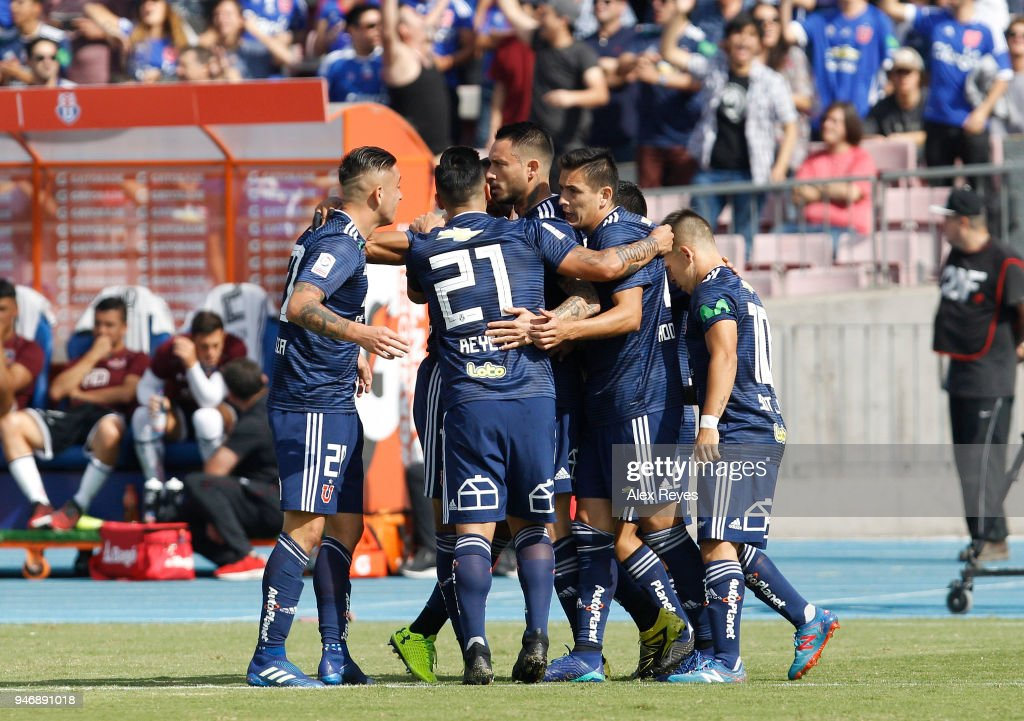 Mauricio Pinilla of U de Chile celebrates with teammates after scoring the first goal of his team during a match between U de Chile and Colo Colo as part of Torneo Scotiabank 2018 at Nacional Stadium of Chile on April 15, 2018 in Santiago, Chile.