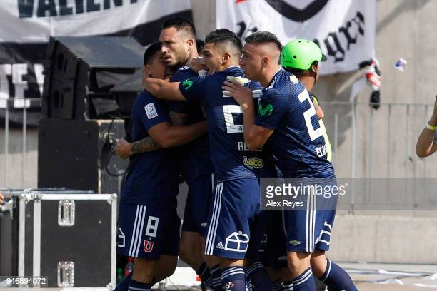 Mauricio Pinilla of U de Chile celebrates with teammates after scoring the first goal of his team during a match between U de Chile and Colo Colo as...