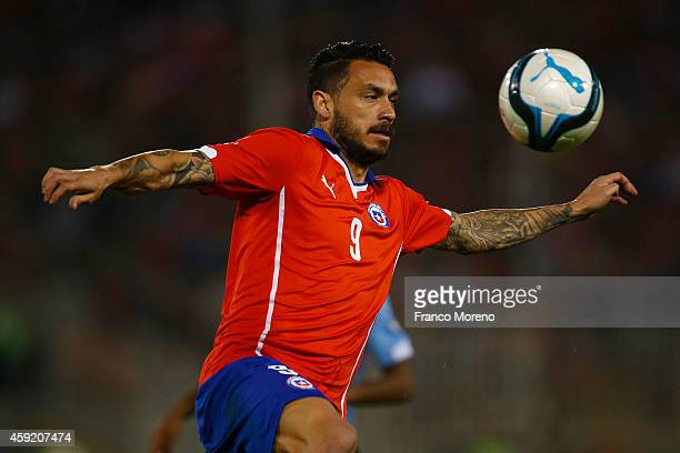 Mauricio Pinilla tries to control the ball during an international friendly match between Chile and Uruguay at Monumental Stadium on November 18 2014...