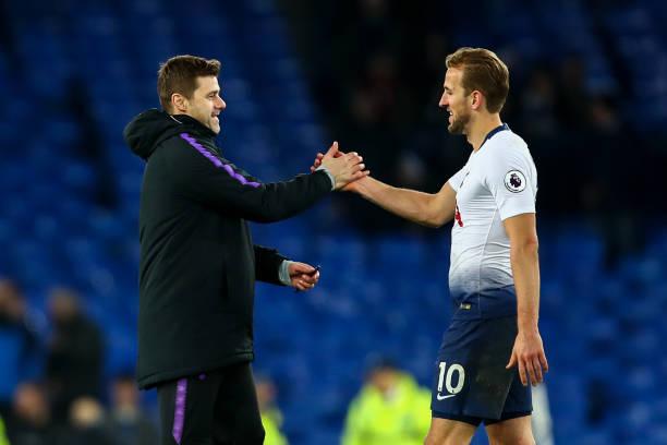 Mauricio Pochettino head coach / manager of Tottenham Hotspur and Harry Kane of Tottenham Hotspur during the Premier League match between Everton FC...