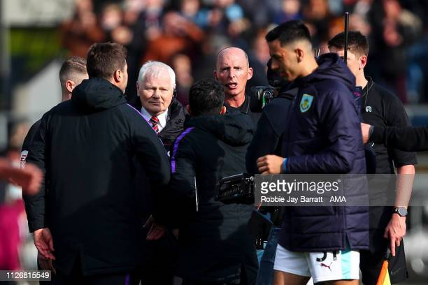 Mauricio Pochettino head coach / manager of Tottenham Hotspur and his coaching staff have a disagreement with Referee Mike Dean at full time during...