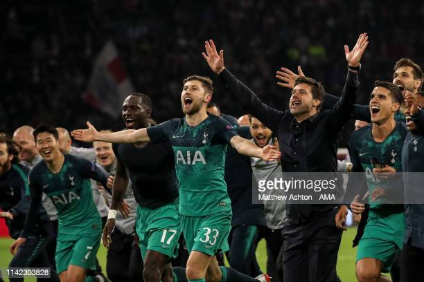 Mauricio Pochettino head coach / manager of Tottenham Hotspur celebrates with his players and coaching staff at full time during the UEFA Champions...