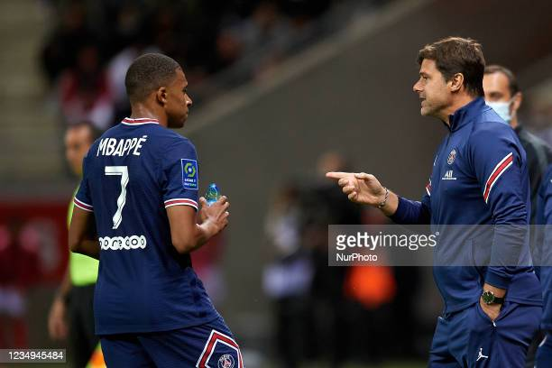 Mauricio Pochettino head coach of PSGgives instructions to Kylian Mbappe during the Ligue 1 Uber Eats match between Reims and Paris Saint Germain at...