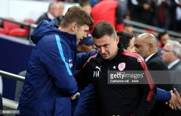 Mauricio Pochettino manager / head coach of Tottenham Hotspur shakes hands with Paul Heckingbottom manager of Barnsley during the Carabao Cup Third...