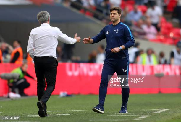 Mauricio Pochettino manager / head coach of Tottenham Hotspur shakes hands with Jose Mourinho the head coach / manager of Manchester United after The...
