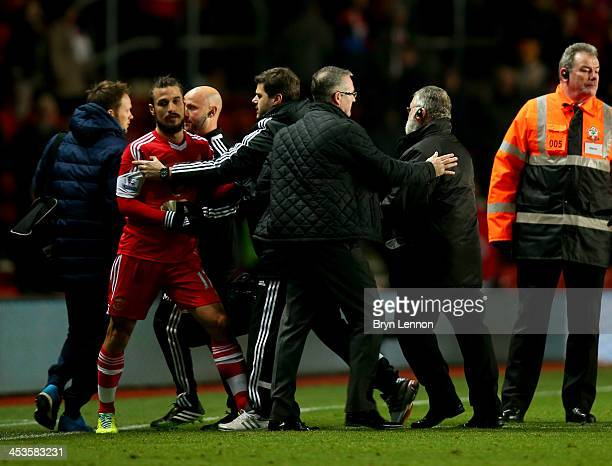 Mauricio Pochettino manager of Southampton holds back Pablo Daniel Osvaldo of Southampton after the Barclays Premier League match between Southampton...
