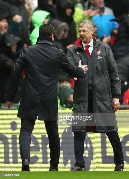 Mauricio Pochettino Manager of Tottenham Hotspur and Arsene Wenger Manager of Arsenal shake hands after the Premier League match between Tottenham...