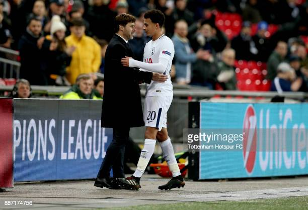 Mauricio Pochettino Manager of Tottenham Hotspur and Dele Alli of Tottenham Hotspur embrace during the UEFA Champions League group H match between...