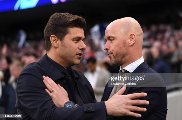 Mauricio Pochettino Manager of Tottenham Hotspur and Erik Ten Hag Manager of Ajax embrace prior to the UEFA Champions League Semi Final first leg...