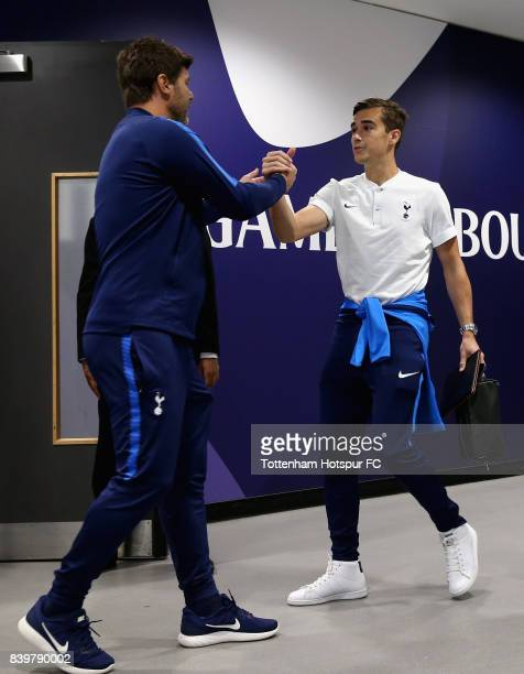 Mauricio Pochettino Manager of Tottenham Hotspur and Harry Winks of Tottenham Hotspur shake hands as they arrive at the stadium prior to the Premier...