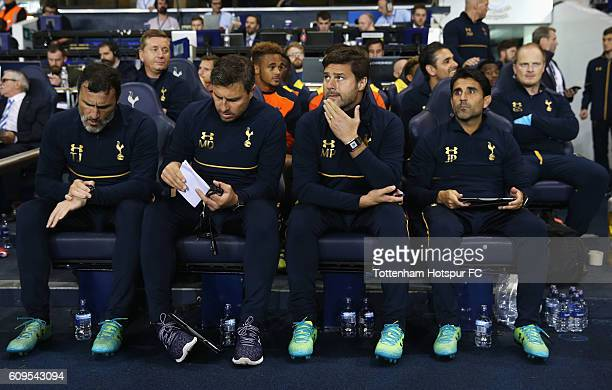 Mauricio Pochettino Manager of Tottenham Hotspur and his backroom staff look on from the bench during the EFL Cup Third Round match between Tottenham...