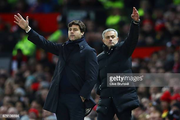 Mauricio Pochettino Manager of Tottenham Hotspur and Jose Mourinho Manager of Manchester United both gesture during the Premier League match between...
