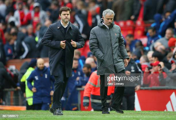 Mauricio Pochettino Manager of Tottenham Hotspur and Jose Mourinho Manager of Manchester United head in for half time during the Premier League match...