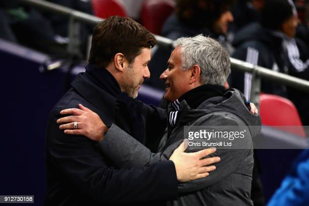 Mauricio Pochettino Manager of Tottenham Hotspur and Jose Mourinho Manager of Manchester United embrace before the Premier League match between...
