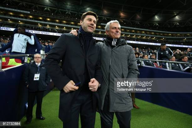 Mauricio Pochettino Manager of Tottenham Hotspur and Jose Mourinho Manager of Manchester United speak prior to the Premier League match between...