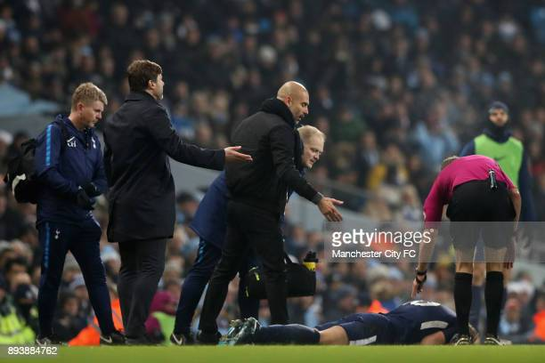 Mauricio Pochettino Manager of Tottenham Hotspur and Josep Guardiola Manager of Manchester City react as Harry Kane of Tottenham Hotspur goes down...
