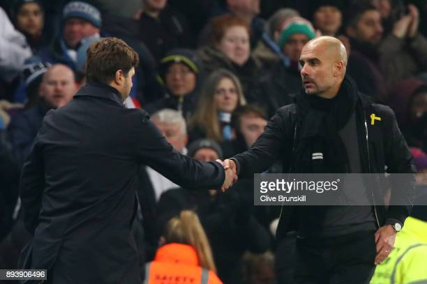 Mauricio Pochettino Manager of Tottenham Hotspur and Josep Guardiola Manager of Manchester City shake hands after the Premier League match between...