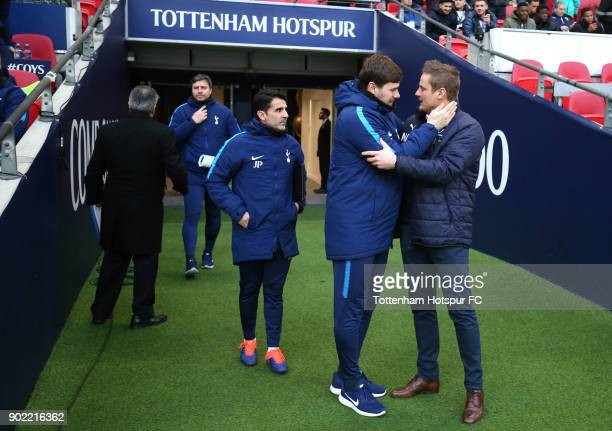 Mauricio Pochettino Manager of Tottenham Hotspur and Neal Ardley Manager of AFC Wimbledon speak prior to The Emirates FA Cup Third Round match...