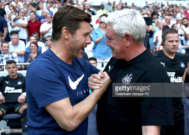 Mauricio Pochettino Manager of Tottenham Hotspur and Steve Bruce Manager of Newcastle United shake hands prior to the Premier League match between...