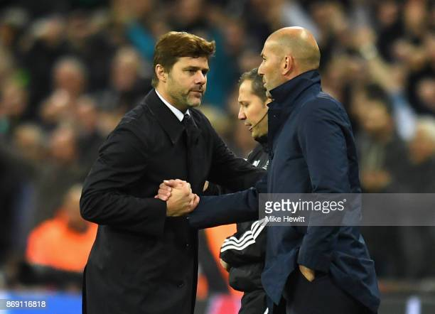 Mauricio Pochettino Manager of Tottenham Hotspur and Zinedine Zidane Manager of Real Madrid shake hands following the game at the UEFA Champions...