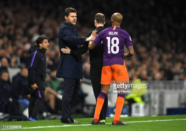 Mauricio Pochettino, Manager of Tottenham Hotspur argues with Fabian Delph of Manchester City during the UEFA Champions League Quarter Final first...