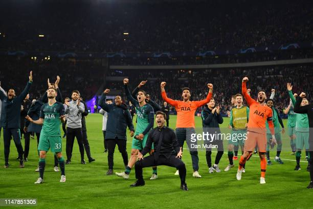Mauricio Pochettino, Manager of Tottenham Hotspur celebrates victory with his team after the UEFA Champions League Semi Final second leg match...