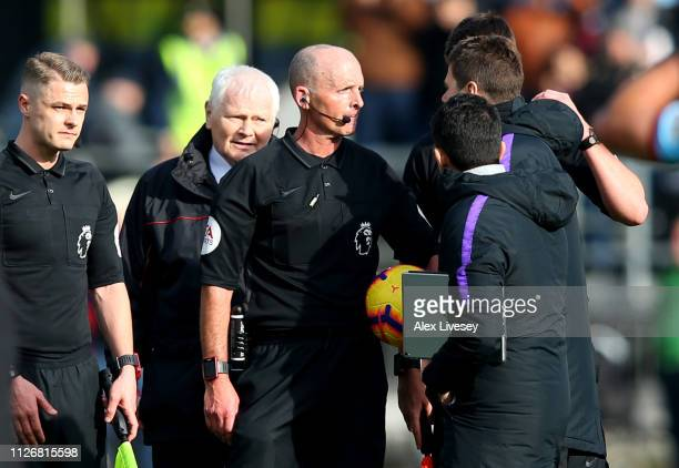 Mauricio Pochettino Manager of Tottenham Hotspur confronts refere Mike Dean following the Premier League match between Burnley FC and Tottenham...