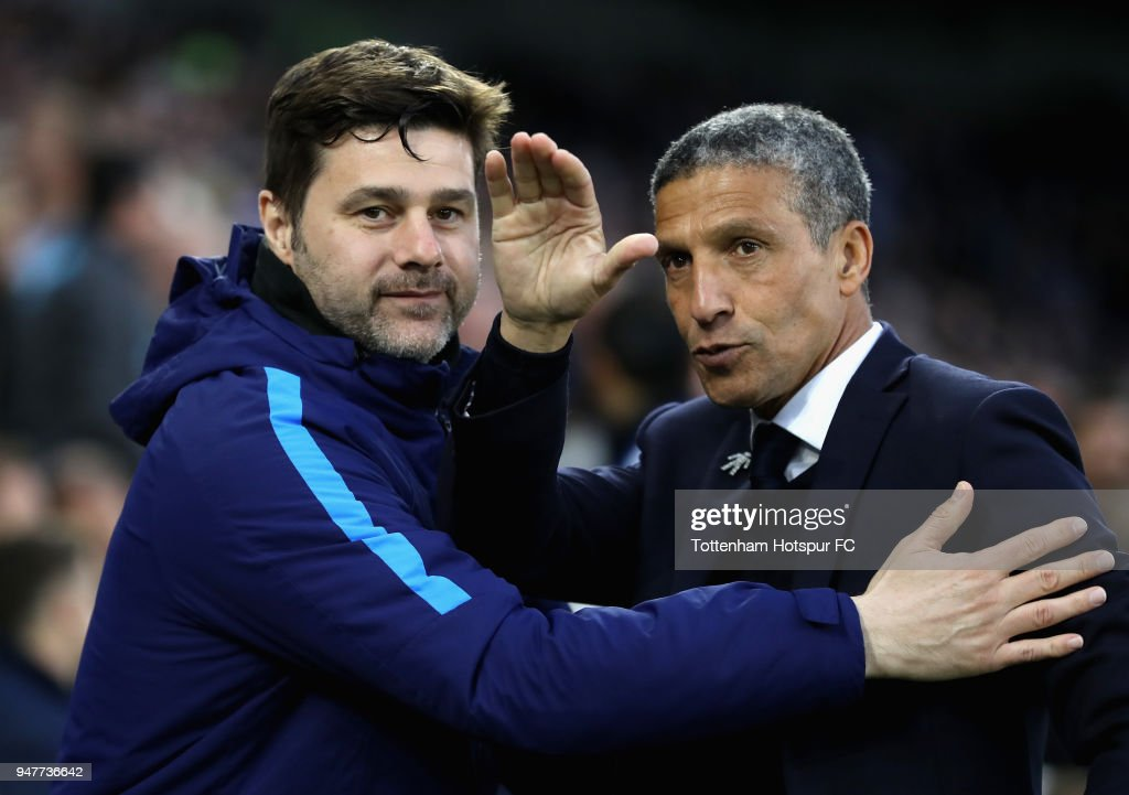 Mauricio Pochettino, Manager of Tottenham Hotspur embraces Chris Hughton, Manager of Brighton and Hove Albion prior to the Premier League match between Brighton and Hove Albion and Tottenham Hotspur at Amex Stadium on April 17, 2018 in Brighton, England.