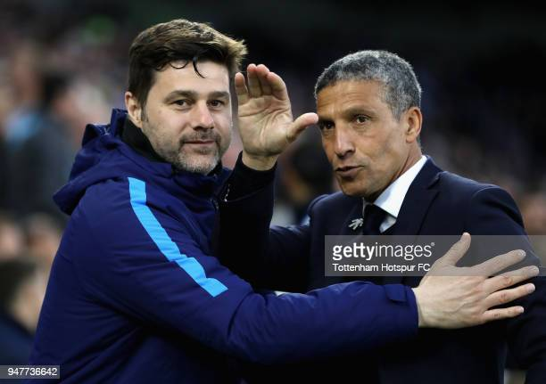 Mauricio Pochettino Manager of Tottenham Hotspur embraces Chris Hughton Manager of Brighton and Hove Albion prior to the Premier League match between...