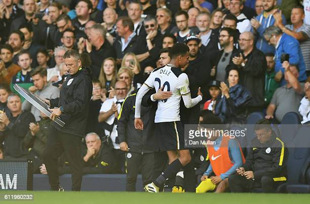 Mauricio Pochettino Manager of Tottenham Hotspur embraces with Dele Alli of Tottenham Hotspur after he is subbed during the Premier League match...