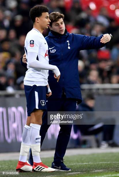 Mauricio Pochettino Manager of Tottenham Hotspur gives Dele Alli of Tottenham Hotspur instructions during The Emirates FA Cup Fourth Round Replay...
