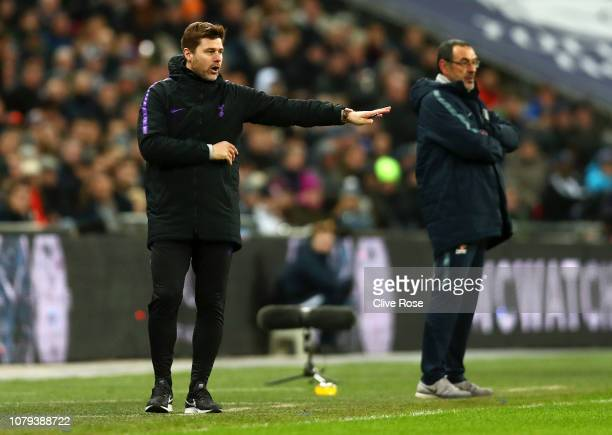 Mauricio Pochettino Manager of Tottenham Hotspur gives his team instructions as Maurizio Sarri Manager of Chelsea looks on during the Carabao Cup...