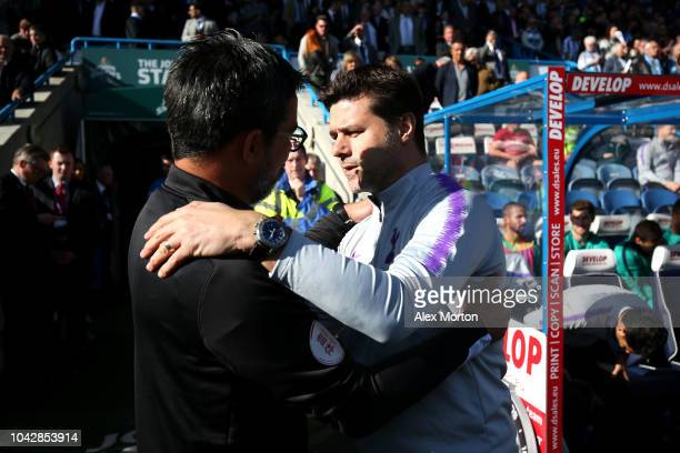 Mauricio Pochettino Manager of Tottenham Hotspur greets David Wagner manager of Huddersfield Town prior to the Premier League match between...