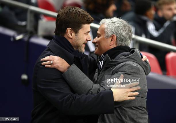Mauricio Pochettino Manager of Tottenham Hotspur greets Jose Mourinho Manager of Manchester United prior to the Premier League match between...