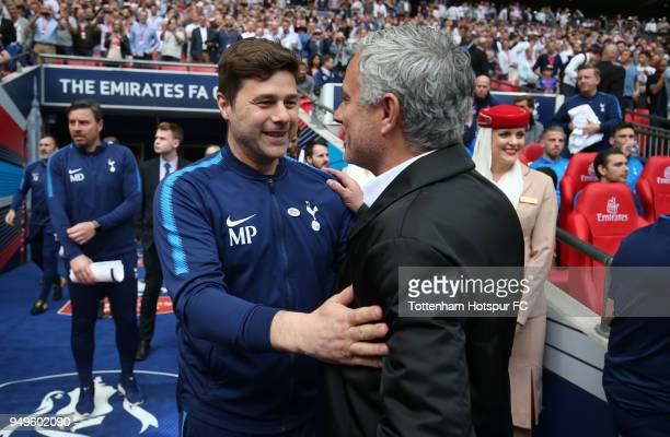 Mauricio Pochettino Manager of Tottenham Hotspur greets Jose Mourinho Manager of Manchester United prior to The Emirates FA Cup Semi Final match...