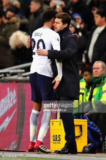 Mauricio Pochettino Manager of Tottenham Hotspur hugs Dele Alli of Tottenham Hotspur during the Premier League match between Tottenham Hotspur and...