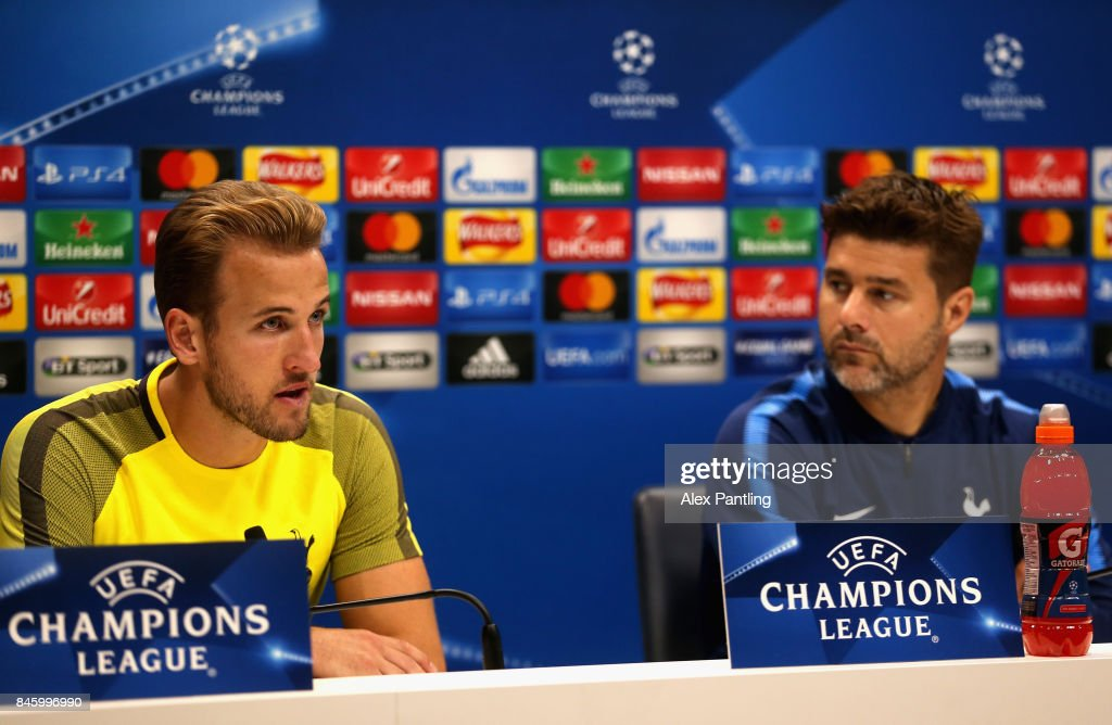 Mauricio Pochettino, Manager of Tottenham Hotspur (R) looks on as Harry Kane of Tottenham Hotspur speaks during a Tottenham Hotspur press conference ahead of their UEFA Champions League Group H match against Borussia Dortmund at Tottenham Hotspur Training Centre on September 12, 2017 in Enfield, England.