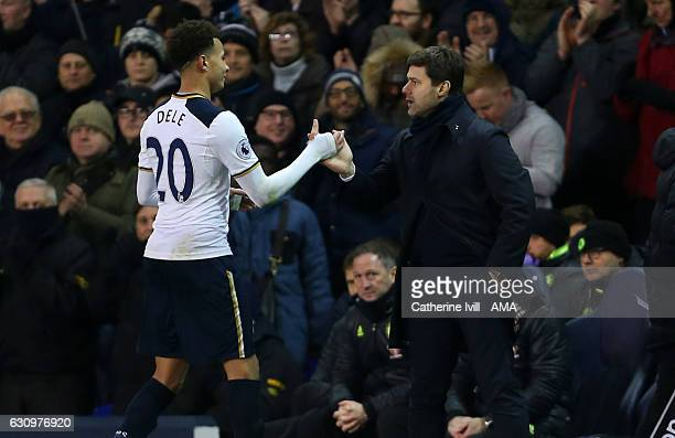 Mauricio Pochettino manager of Tottenham Hotspur shakes hands with Dele Alli of Tottenham Hotspur during the Premier League match between Tottenham...